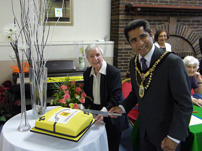 Mayor Cutting Cake